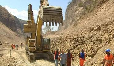 Constructing dams in Africa using heavy equipment